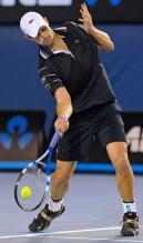 Andy Roddick hits a low ball at the 2010 Australian Open.JPG