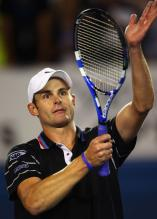 Andy Roddick celebrates by clapping on his racket at the 2010 Australian Open.JPG