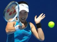 Zhang Jie hits a forehand during the 2010 Australian Open.JPG