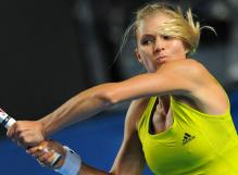 Maria Kirilenko hits a 2 handed backhand at the 2010 Australian Open.JPG
