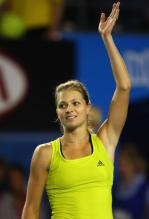 Maria Kirilenko raises her arm in celebration after being Maria Sharapova at the 2010 Australian Open.JPG
