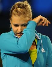 Maria Kirilenko wipes her brow in teal warmup jacket.JPG
