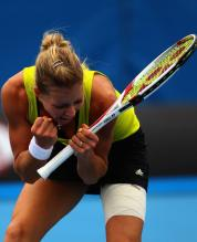 Maria Kirilenko bends down to celebrate a point during the 2010 Australian Open.JPG