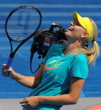 Maria Sharapova laughs during practice.JPG