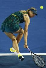 Maria Sharapova scrambles and hits a defensive shot at the 2010 Australian Open.JPG