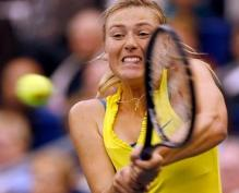 Maria Sharapova hits a 2 handed backhand in a yellow Nike dress.JPG