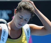 Ana Ivanovic leaves the 2010 Australian open disappointed.JPG