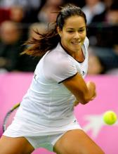 Ana Ivanovic racket back to hit the 2 handed backhand during Fed Cup 2010.JPG