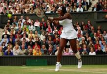 Serena Williams jumps in the air with backhand.jpg