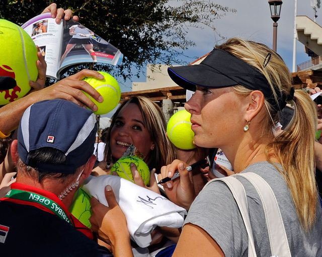 Maria Sharapova is surrounded by fans at Indian Wells ...