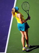 Maria Sharapova in yellow top and green-blue skirt.JPG