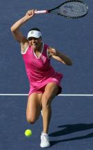 Vera Zvonareva goes down load to lift up a shot at Indian Wells 2010.JPG