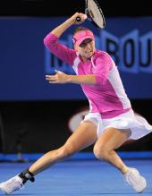 Vera Zvonareva gets down load to hit a forehand and stops.JPG