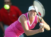 Vera Zvonareva hits a 2 handed backhand on the run.JPG
