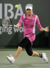 Vera Zvonareva moves to hit a defensive forehand at Indian Wells.JPG