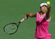 Vera Zvonareva ball toss on her serve at Indian Wells 2010.JPG