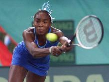 Venus Williams reach out for the tennis ball with her two-handed back hand.jpg