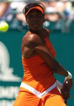 Venus Williams receives with her two-handed back hand.jpg