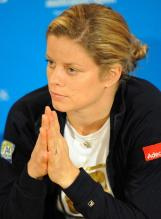 Kim Clijsters in a black jacket listens to a question after her loss at the 2010 Australian Open.JPG