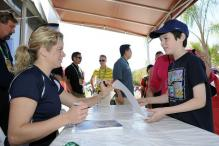 Kim Clijsters signs an autograph for a young fan.JPG