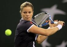 Kim Clijsters sticks out her tongue as she prepares to hit a slice.JPG