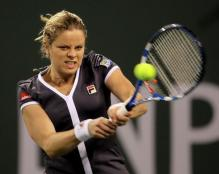 Kim Clijsters hits a 2 handed backhand in a Fila gray tennis outfit.JPG