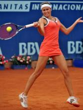 Gisela Dulko hits a high ball forehand.JPG