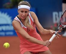 Gisela Dulko looks to hit a backhand volley.JPG