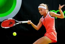 Gisela Dulko hits a sweeping forehand in Miami 2010.JPG