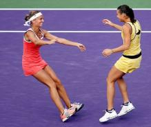 Gisela Dulko and Flavia Pannetta are giddy after winning the Sony Ericsson doubles championship 2010.JPG