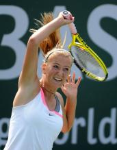 Victoria Azarenka same shoulder follow-through on her forehand.JPG
