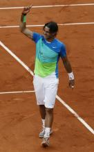 Rafael Nadal holds up his index finger as he becomes the number one player in the world after winning the 2010 French Open.JPG