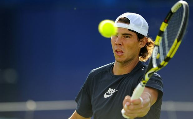 Rafael Nadal Hits A Forehand Volley During Practice Jpg