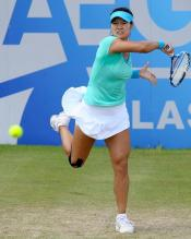 Li Na full torso twist on an inside-out forehand.JPG