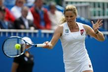 Kim Clijsters hits a topspin forehand with her Babolat racket at AEGON 2010.JPG