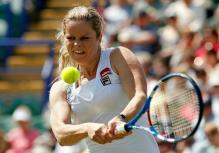 Kim Clijsters hits a 2 handed backhand at the AEGON International tournament 2010.JPG