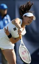 Zheng Jie follows through on a serve at the AEGON International tennis tournament 2010.JPG