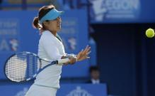 Li Na looks to hit a driving forehand with her Babolot racket.JPG