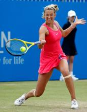 Victoria Azarenka bends down and hits a forehand on grass.JPG
