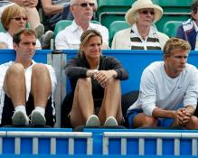 Amelie Mauresmo watches Michael Llodra play.JPG