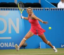 Victoria Azarenka racket back ready to smack a forehand on grass.JPG