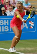 Victoria Azarenka defensive slice backhand on grass.JPG