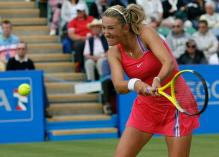 Victoria Azarenka ready to hit a two handed backhand on grass.JPG