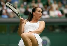 Jelena Jankovic tries to will a shot in during 2010 Wimbledon.JPG