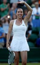 Jelena Jankovic waves after winning her 2010 Wimbledon second round match.JPG