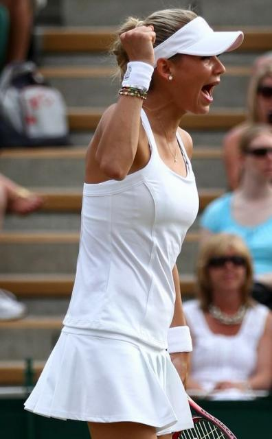 Anna Kournikova celebrates a point during her Wimbledon 2010 doubles match.JPG