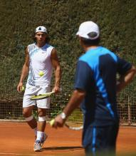 Nadal talks to his coach and uncle Toni Nadal.jpg