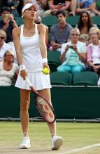 Anna Kournikova gets ready to toss the ball on her serve.JPG