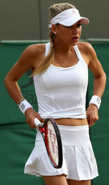 Anna Kournikova adjusts her skirt during her Wimbledon 2010 doubles match.JPG