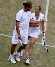 Kim Clijsters has a laugh with Xavier Malisse during mixed doubles Wimbledon 2010.JPG